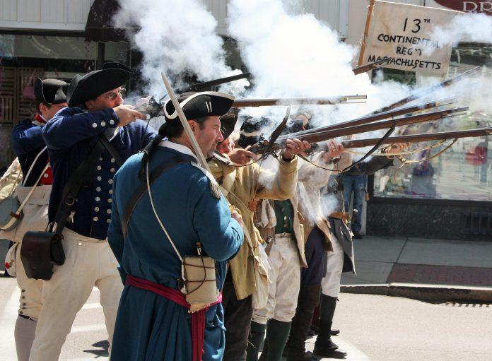 Historical re-enactors fire