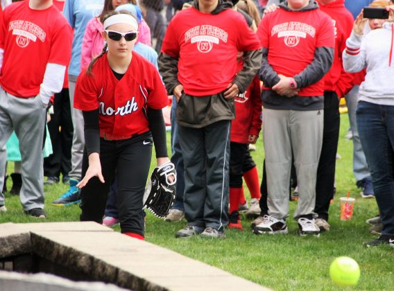 Maddy Bloom throws an opening pitch to Mack Duffy