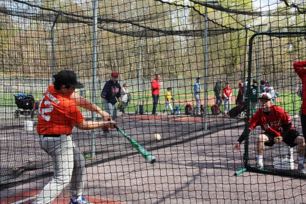 Andrew Custodio takes a swing