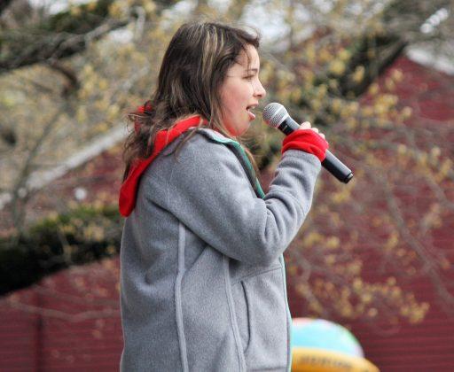 Elizabeth Szgata sings the National Anthem